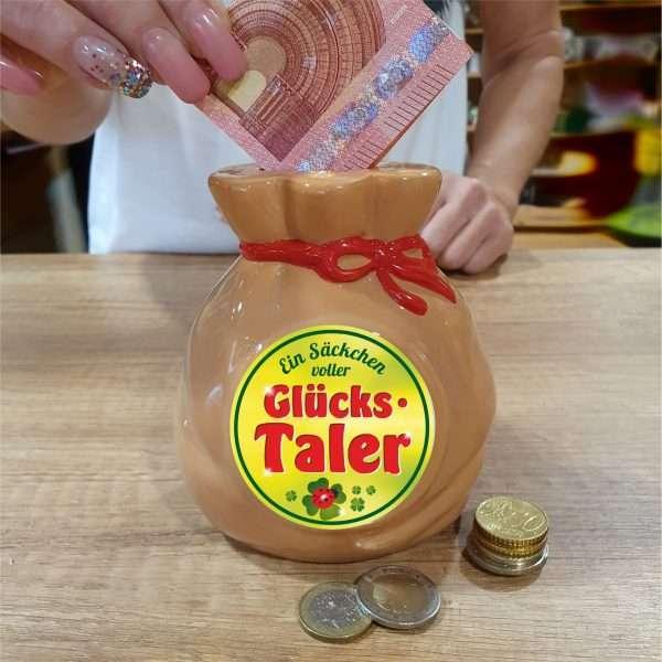 Spardose-Sparschwein-Ein-Saeckchen-voll-Glueckstaler-Geld-Sack-andrea-geschenke.de-AV-Andrea-Verlag